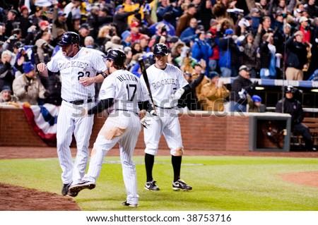 DENVER, COLORADO - OCTOBER  12: Jason Giambi celebrates with Todd Helton after scoring in game 4 of the Colorado Rockies, Philadelphia Phillies series on October 12, 2009 in Denver Colorado.