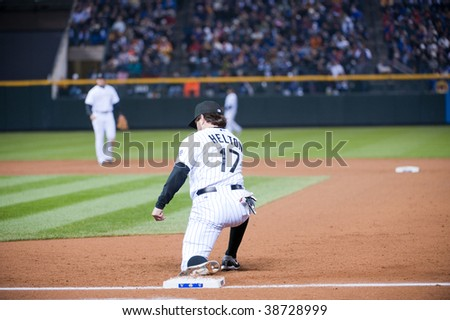 DENVER, COLORADO - OCTOBER 11: Todd Helton makes a routine out at first base in game 3 of the National League Division Series  at Coors field on October 11, 2009 in Denver Colorado.