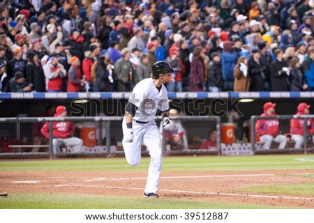DENVER, COLORADO - OCTOBER 12: Troy Tulowitzki of the Rockies heads for first base in game 4 of the Colorado Rockies, Phillies National League Division Series on October 12, 2009 in Denver Colorado.