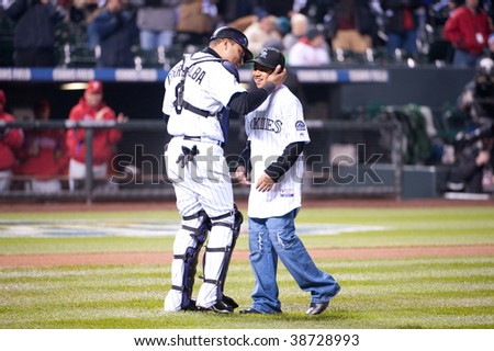 DENVER, COLORADO - OCTOBER 11: Yorvit Torrealba's son threw out the first ball during  game 3 of the National League Division Series  at Coors field on October 11, 2009 in Denver Colorado.