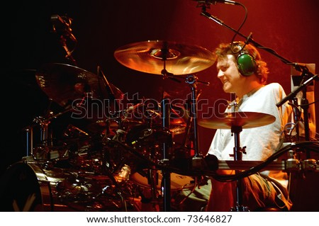 DENVER - DECEMBER 17: 	Drummer Rick Allen of the Heavy Metal band Def Leppard performs in concert December 17, 2002 at the Magnus Arena in Denver, CO.