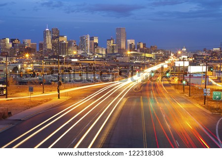 Denver. Image of Denver and busy street with traffic leading to the city.
