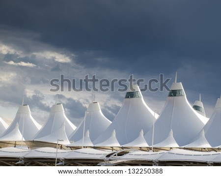 Denver International Airport well known for peaked roof. Design of roof is reflecting snow-capped mountains. #132250388