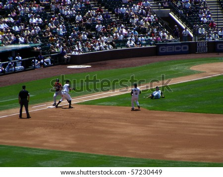 DENVER - JUNE 29: Byung-Hyun Kim, the Rockies pitcher, slips and falls as he tries to make the play at first base in a game at Coors Field against the Houston Astros June 29, 2005 in Denver, Colorado