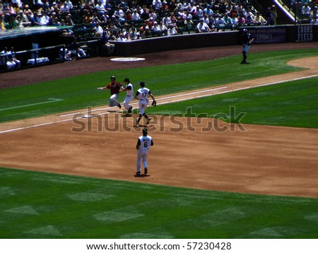 DENVER - JUNE 29: Craig Biggio of the Houston Astros slides safely into first base in a game at Coors Field against the Colorado Rockies June 29, 2005 in Denver, Colorado