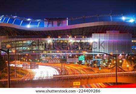 Denver Mile High Stadium, Colorado, United States. Mile High Stadium and Interstate 25 Traffic Evening Commute.