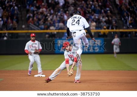 DENVER - OCTOBER  12: Dexter Fowler hurdles Phillies second baseman in game 4 of the Colorado Rockies/Philadelphia Phillies series on October 12, 2009 in Denver.