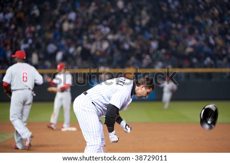 DENVER - OCTOBER 11: Troy Tulowitzki shows his frustration after making the last out in game 3 of the National League Division Series at Coors field on October 11, 2009 in Denver.