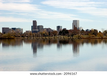 Denver's skyline with Sloan's lake in foreground on a beautiful calm autumn day.