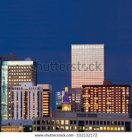 Denver skyline at dusk closeup with colorful sunset reflection in the windows