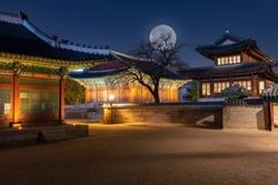 Deoksugung Palace with full moon at night Seoul,South Korea.