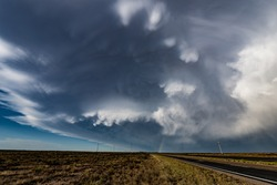 Departing supercell storm with impressive mammatus and a rainbow near Roswell, New Mexico, US.