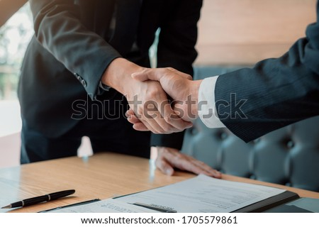 Department heads manager are shaking hands and accept to new employee in office room. Stock foto ©