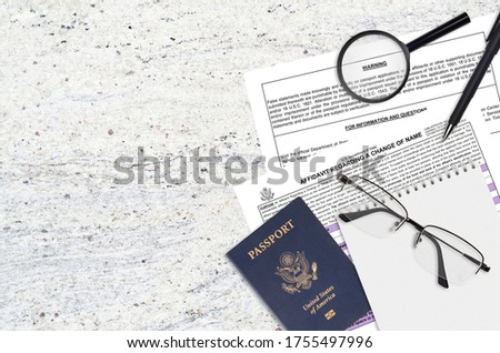Department of State form DS60 Affidavit Regarding a change of name lies on table and ready to fill. Paperwork during operations with US Passport concept Photo stock ©