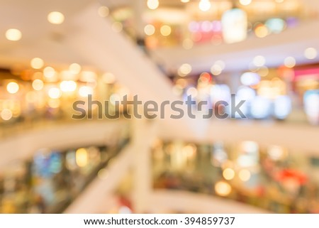 Department store shopping mall blur background with bokeh - Warm lighting decoration #394859737