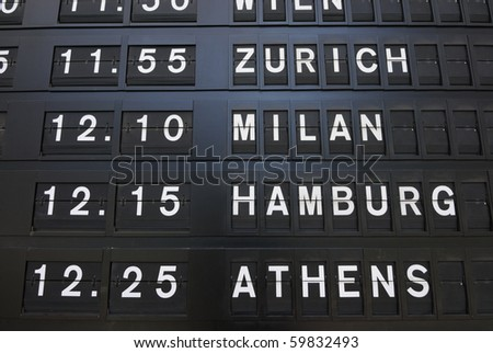 Departure times on an analog sign.