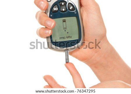 Dependent first type Diabetic patient measuring glucose level blood test using ultra smart sugar glucometer and small drop of blood from finger and test strips isolated on a white background