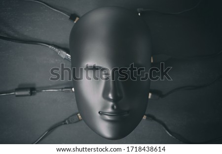 Depersonalized human robot android face connected with many digital device wires cables chargers. Digitalization, chipization, artificial intelligence, futuristic cyborg concept in total black color. Stock fotó ©