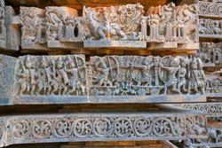 Depiction of Arjuna-Bhishma war from Mahabharata, at the base of temple, Hoysaleshwara temple, Halebidu, Karnataka, India.