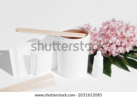 depilation sugaring wax in white container with spatula and strips fot hair remove. skin care, smooth skin treatment. home depilation set Stock fotó ©