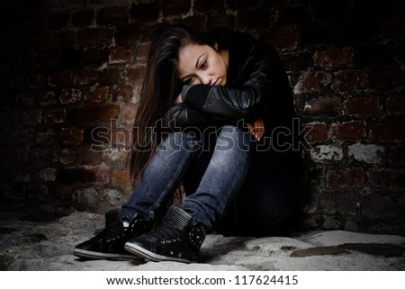 Depressed and lonely teenage girl, sad expression face. - stock photo