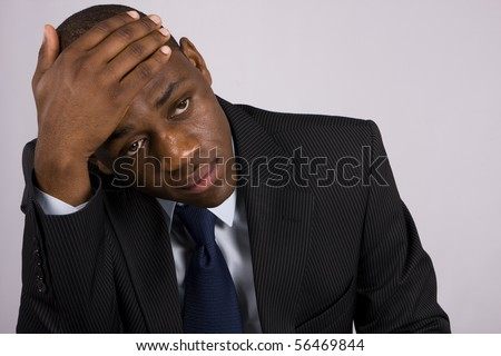 Depressed Business man having an headache