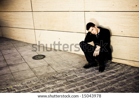 Depressed businessman in urban background