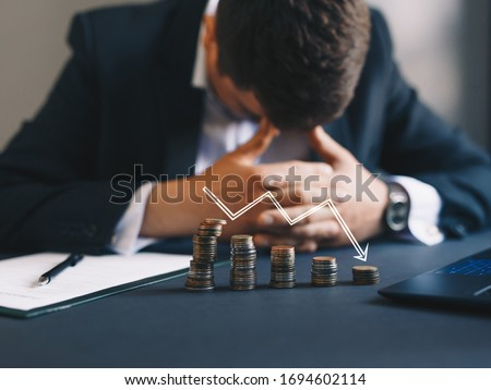 Depressed businessman lost his business. Destroyed businessman. Concept of business loss, bankruptcy and crisis.  Сток-фото ©