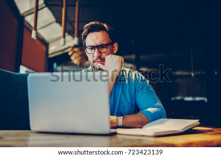 Depressed male entrepreneur feeling headache can't solve problems with finance checking report on netbook.Stressed manager worried about documentation on laptop failure with saving on software
