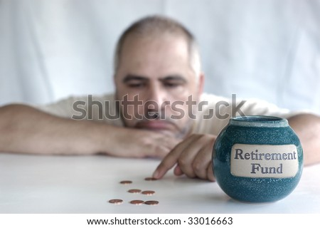 depressed man counting pennies from retirement fund