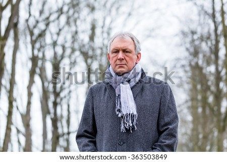 Depressed or sad man walking in winter