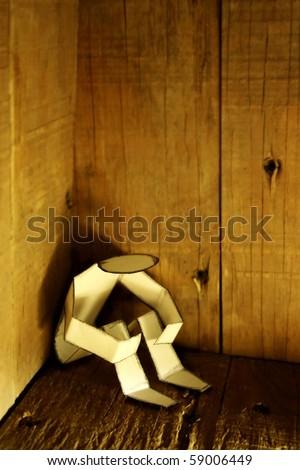 depressed paper person in corner