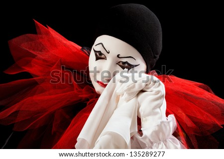 Depressed Pierrot crying in a white handkerchief
