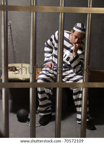 Depressed prisoner in a prison cell.