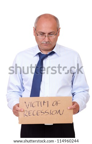 Depressed senior businessman holding a cardboard and asking about help, isolated on white background