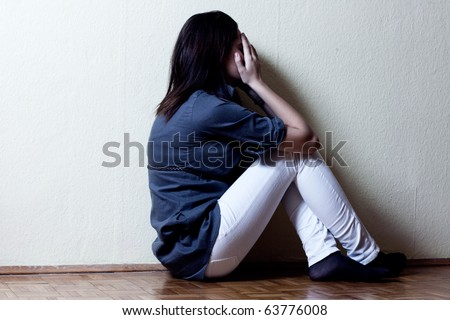 Depressed teenage girl cover the face with her hands.