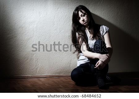 Depressed teenager girl sitting on floor. #68484652