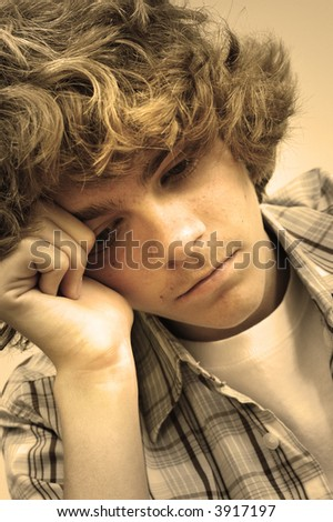 Depressed teenager trying to cope with whatever is causing him grief and problems