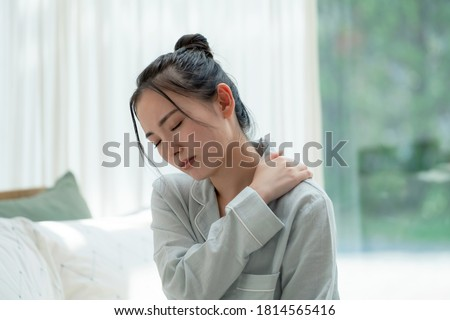 Depressed young asian woman in bedroom. Stock photo ©