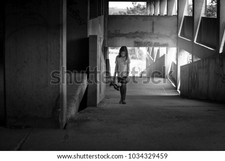 Depressed young girl walking alone in an abandoned building, Children with Behavioral and Emotional Disorders