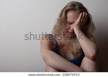 depressed young lonely woman girl, sitting on the floor alone and crying