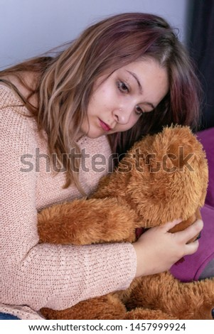 Depressed young woman crying alone at home, upset girl sitting on sofa, feeling unhappy after quarrel or disintegration, despair and lonely, psychological problem concept.