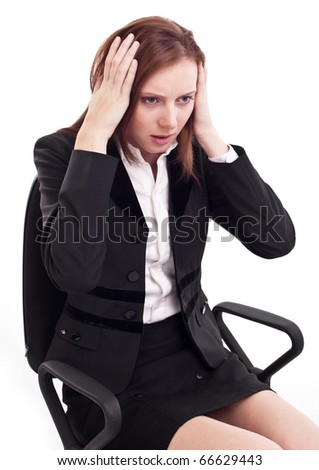 Depressed young woman sitting on a chair, clutches her head.