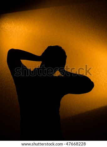 Depression and pain - silhouette of man in the darkness
