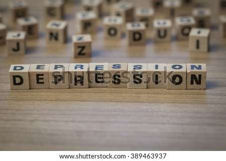 Depression written in wooden cubes on a table