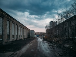 Depressive territory of abandoned industrial area, old warehouses