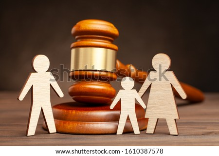 Deprivation of the parental rights of the Father. The law protects children from dad violence. Mother with child apart from father and judge's hammer Stock photo ©