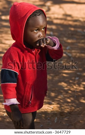 Deprived African child, village near Kalahari desert, people diversity series