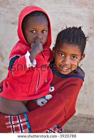 Deprived African children, sister and brother, village near Kalahari desert, people diversity series