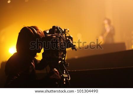 Depth of field image of an unidentified cameraman at an unknown concert in Tokyo, Japan Сток-фото ©